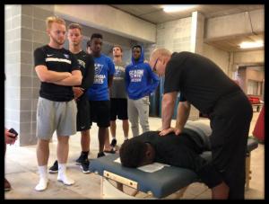 Dr. Eric Plasker Adjusts Division 1 Athletes on the Georgia State Soccer Team