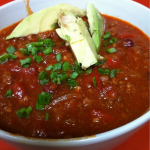 Healthy Beef Chili served with Avocado and Green Onions